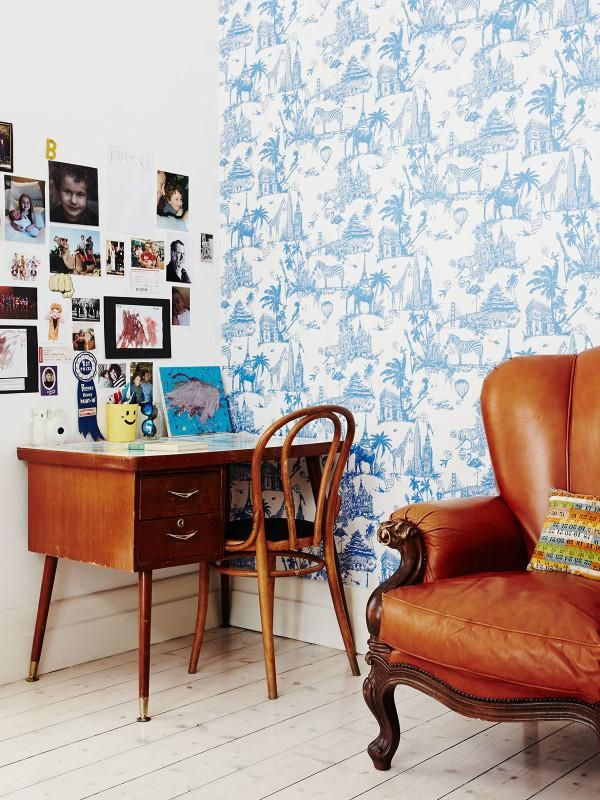 Patterned wallpaper ups the charm of this cozy work corner.