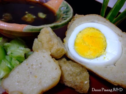 Pempek Palembang: fish meatball with egg in the center. We name it 'kapal selam' literally means 'submarine'. Served with spicy vinegar called 'cuko'.