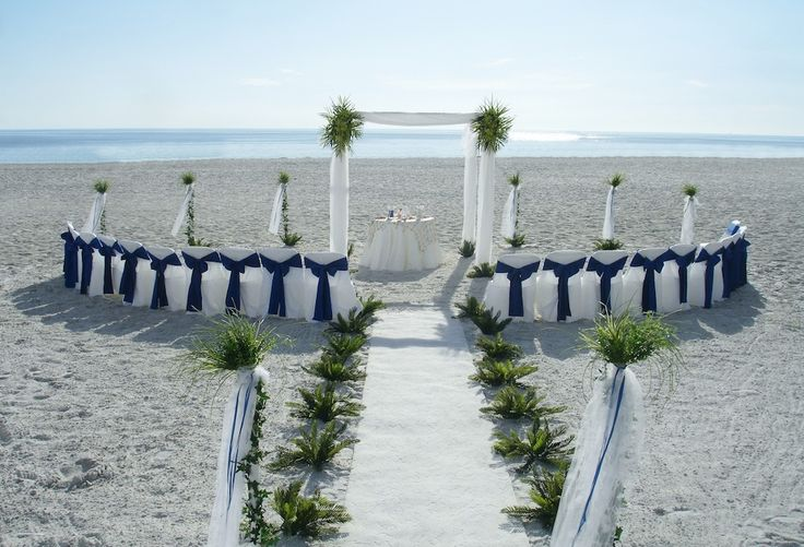 white wedding arches for beach weddings | elegant and simple setting with blues whites and the greens