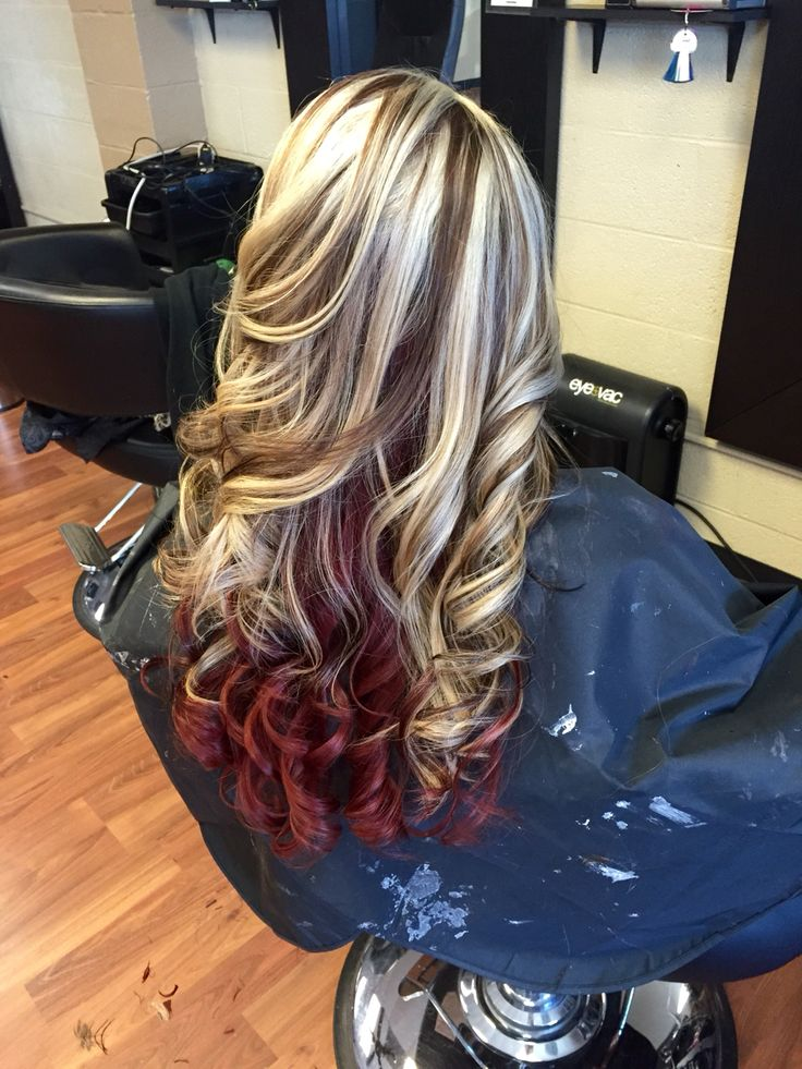 Platinum blonde with mocha brown lowlights and red underneath.