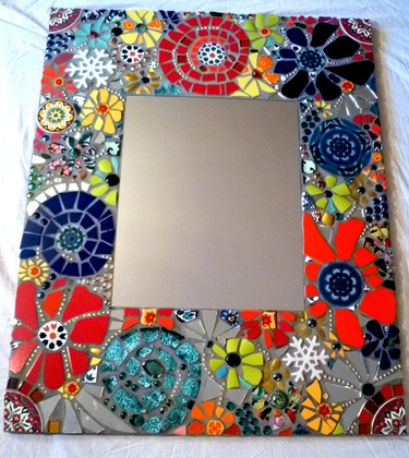 striking mosaic mirror on European shop site. Lovely eye candy for most of us. Inspiration for some and an heirloom piece for someone lucky enough to buy it.