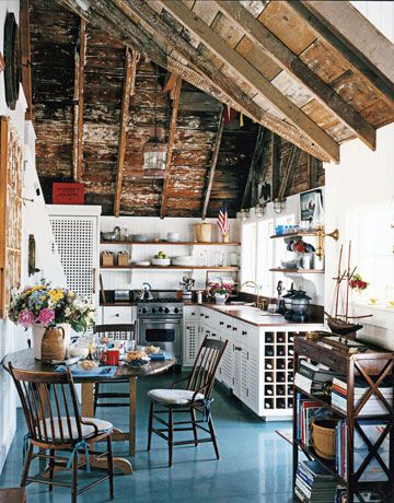 when i have a little beach house, this is what i want the kitchen to be like. just enought modern to look nice, just enough run down to make it comfy :)