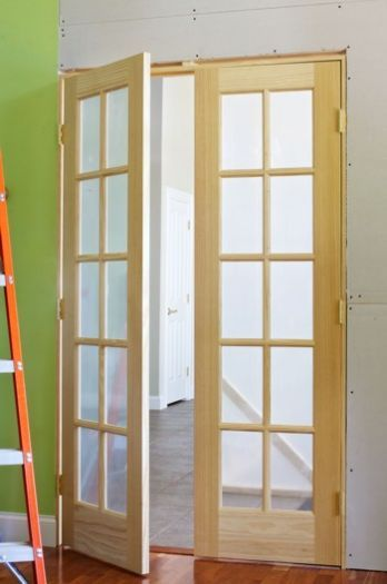 DIY interior french doors  - I've been thinking of these for the dining room area...would be easier to heat/cool the house if that space was enclosed...