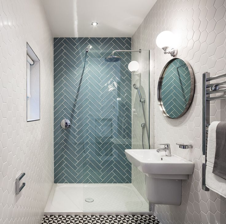 Small quirky bathroom design with seamless double shower, hexagonal wall tiles, herringbone wall tiles and geometric floor tiles. Designed by Kingston Lafferty Design. www.kingstonlaffertydesign.com