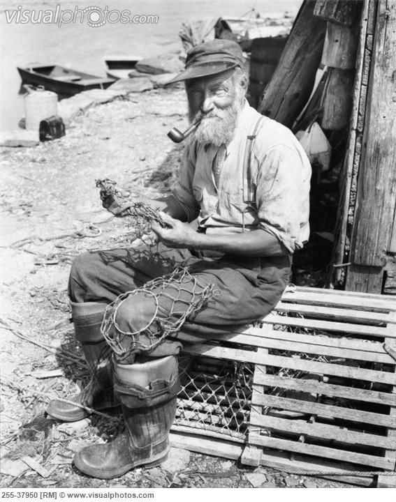 Portrait of a fisherman sitting on a lobster trap