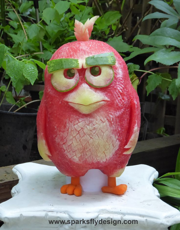 "Just in time for the Angry Birds Movie, Clive Cooper carves ""Red Bird"" in a watermelon. Love the wee carrot feet! Angry Birds, the Watermelon edition!"