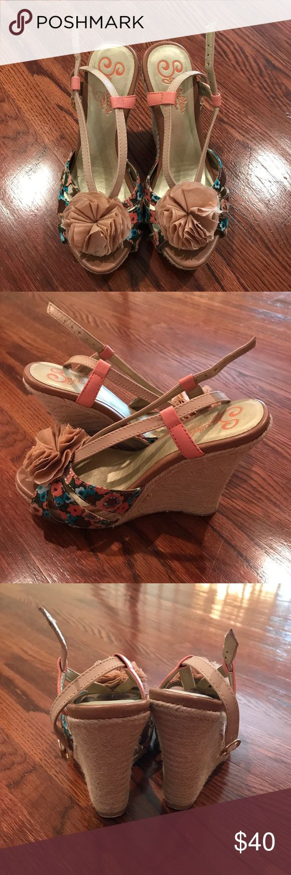 Seychelles Wedge Sandals! These Seychelles Wedge Sandals have a pretty floral pattern with flower detail on the front of the shoe, perfect for Spring, Summer, and into Fall! Minimal wear-they run a little small which is why I am selling. 4 1/2 inch wedge with 1 inch platform. Seychelles Shoes Wedges