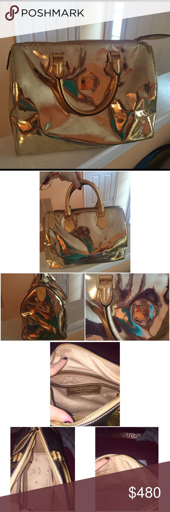 "MCM Gold Metallic Bag W 6"" x L 12"" x D 8"". Strap 4"" Does have some scratches but because of the shine of the bag they are not noticeable! Comes with dust bag. PRICE IS NEGOTIABLE BUT WITHING REASON! MCM Bags"
