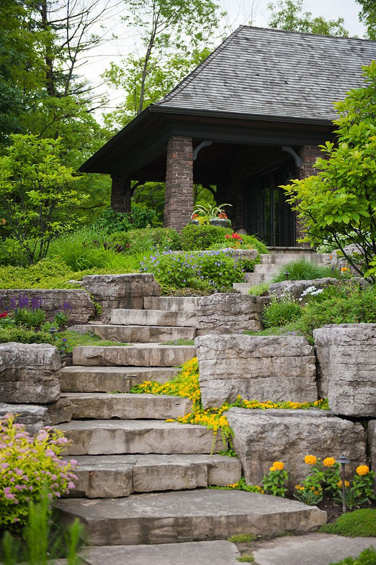 The natural stone steps of a stairway garden feature climb a small - Love How The Plants Spill Out Onto The Stone Stairs Shademaster Landscaping