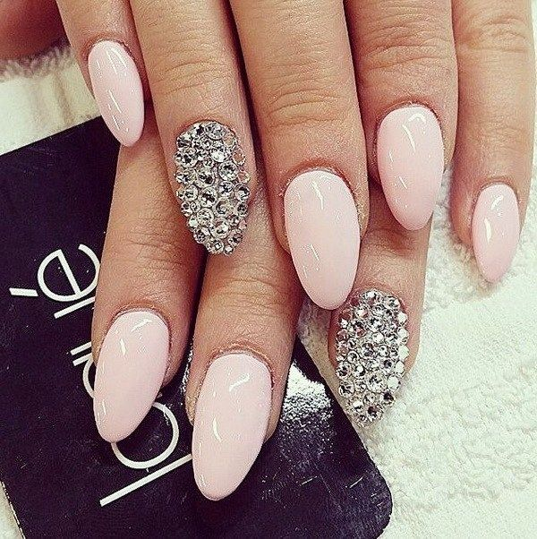 Light Pink Almond Nails with Silver Applications.