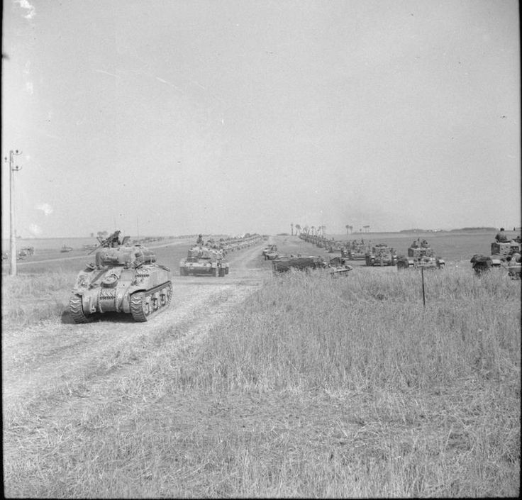 Sherman and Cromwell tanks of the 1st Polish Armoured Division on the move at the start of Operation 'Totalise'.