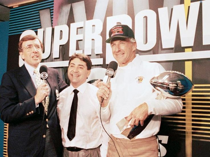 Owner Eddie DeBartolo and Head Coach George Seifert celebrate the 49ers victory over the Denver Broncos in Super Bowl XXIV on January 28, 1990.