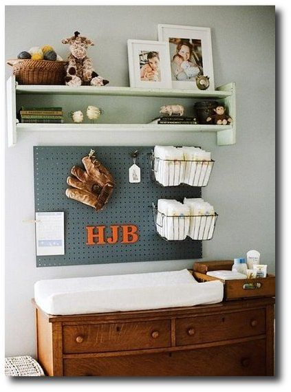 Clever use of peg board over a changing table with wire baskets for baby supplies. Seen at Apartment Therapy Blog