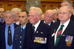 Thoughtful reflection by attendees at the ceremony, including Sergeant Craig Pitman RNZAF, Mr Colin Fraser (ex-RNZAF - Second Word War, J Force, and the Berlin Airlift), and Mr Trevor Dean (ex-NZ Army - Malayan Emergency). Mr Fraser and Mr Dean were also among the 16 recipients of the NZOSM at this inaugural presentation.