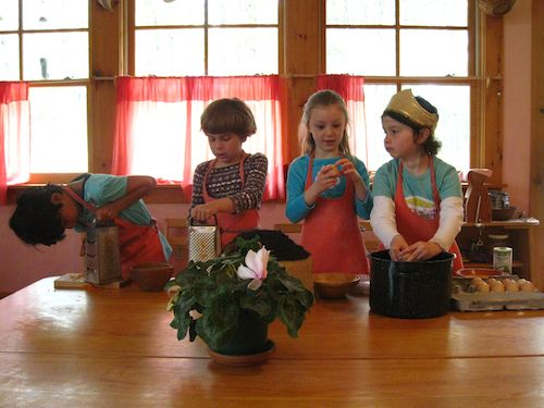 """It's """"Soup Day,"""" in my Waldorf kindergarten class. My assistant and I arrived early to don our aprons and prepare for the day. A basin full of water has been set on the table. Vegetable scrub brushes lay nearby."""