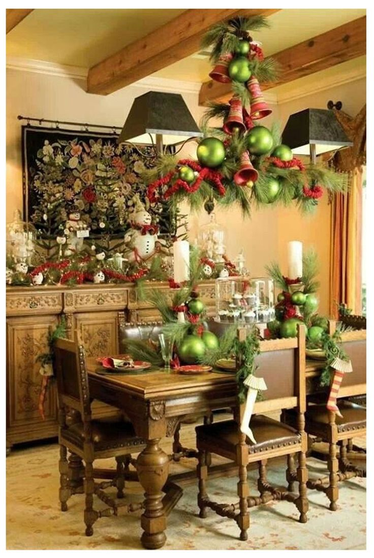 141 best dining room images on pinterest christmas dining rooms decorating the dining room for christmas sideboard centerpiece chairs chandelier such a cozy feeling to this room