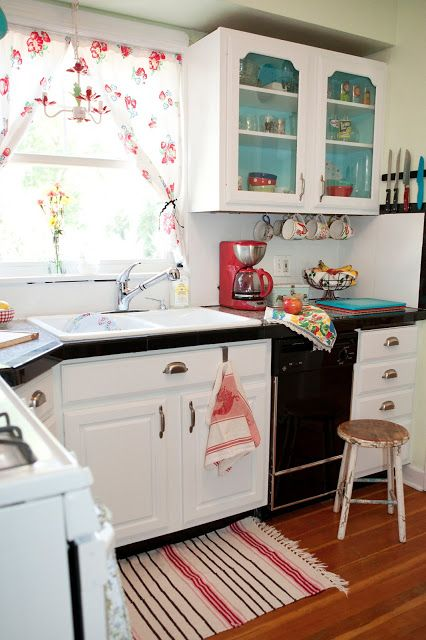 A Sort Of Fairytale: Budget Cottage Kitchen. Teals and reds together. Also the painted shelves for pop of color.