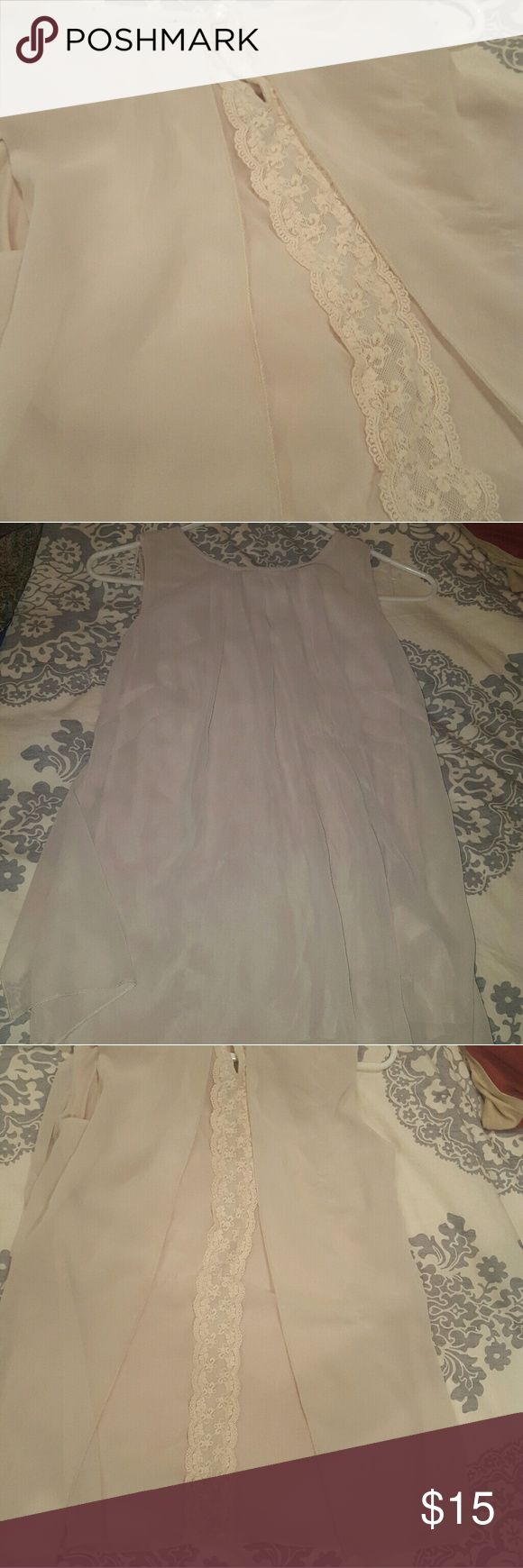Beautiful peah silky top w/ back lace detail Sleeveless flowy peach top with back that has lace detail, as pictured. Very feminine and would be great for work or wearing out spring summer and fall. Yest Tops Blouses