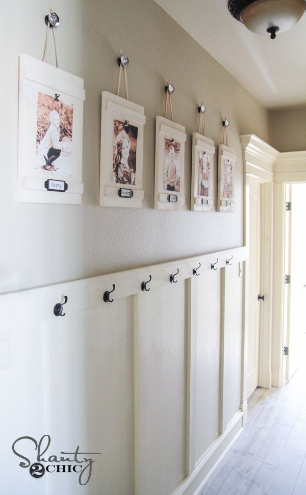 Love the hanging pictures (hallway? Foyer?)