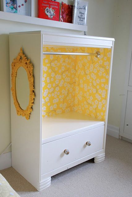 Turn an old dresser into a mini baby closet. Great idea if you don't have the closet space.