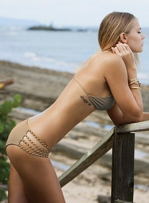 Shimmery taupe fixed triangle top with chainlink racerback and gold logo clasp in center. Shimmery taupe low-rise hipster bottom with sexy gold chain link cut out detail on sides by Tori Praver Swimwear, $220.00