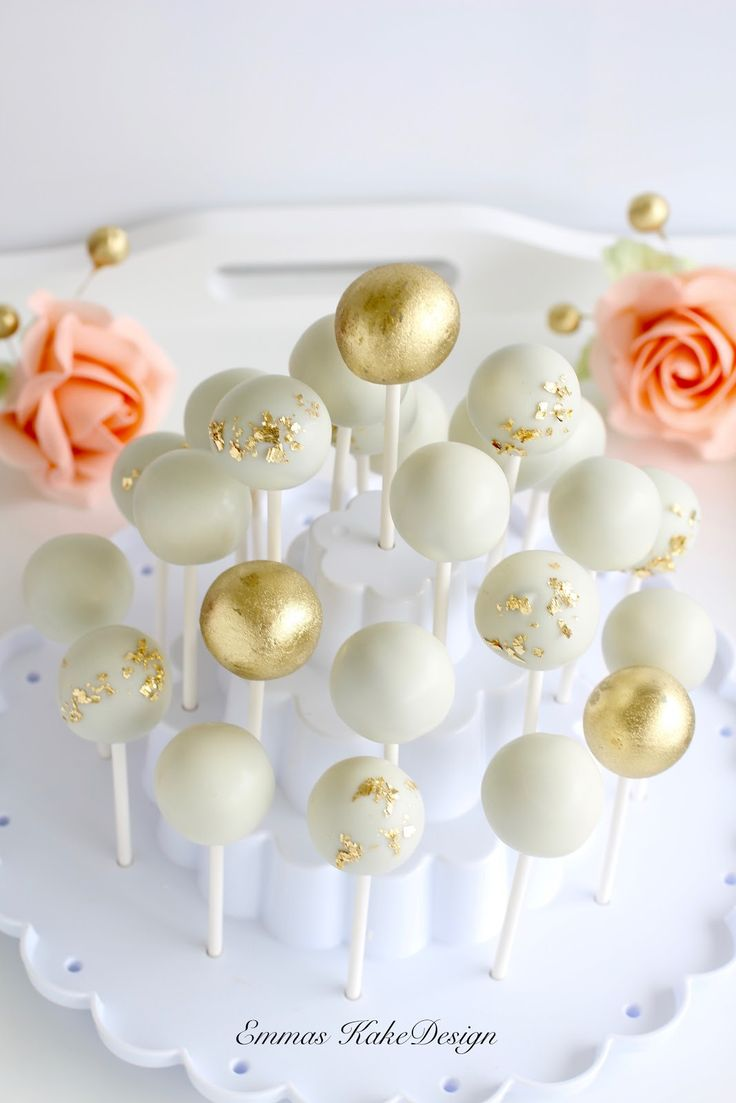 Cake Pops with a touch of gold! See my tutorial on the blog for description. Www.emmaskakedesign.blogspot.com