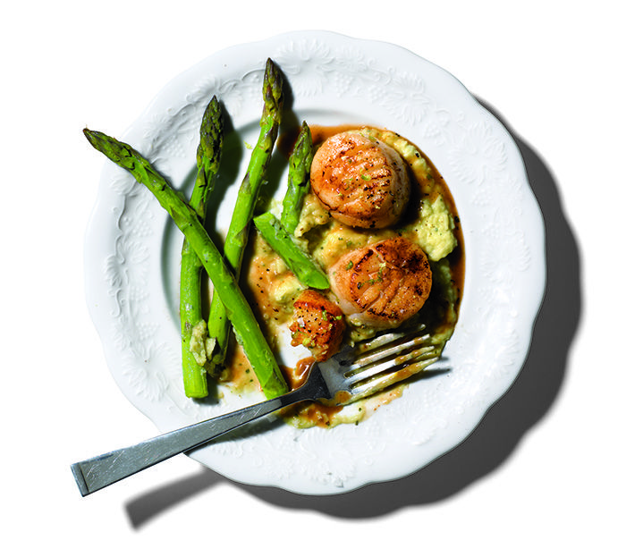 Pan-seared scallops with butter bean mash and asparagus