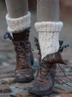 Boots. I'm liking the beaten up, masculine boot look, and the super thick socks sticking out the top.