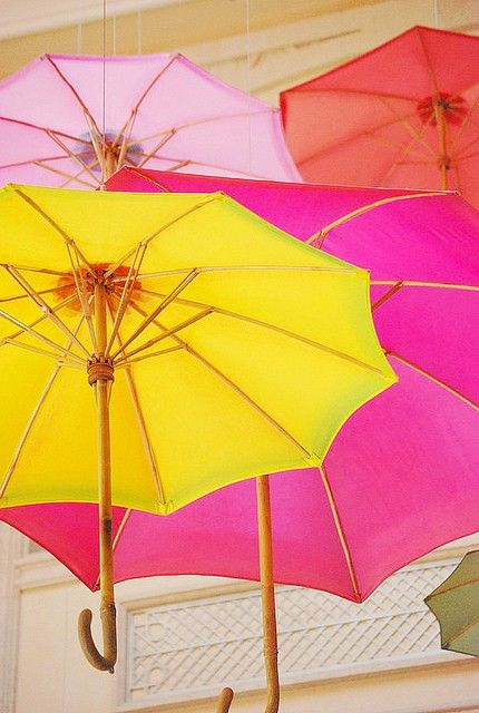Colorful brollies waiting for their very own Mary Poppins !!