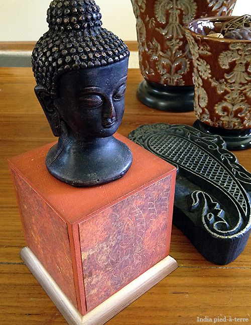 Buddha Head repainted - I made a base for this Buddha head that was gifted to us by my sister-in-law in India. She gave it to us for the India pied-a-terre. Whenever I get back to India again, it will go back with me and live there.