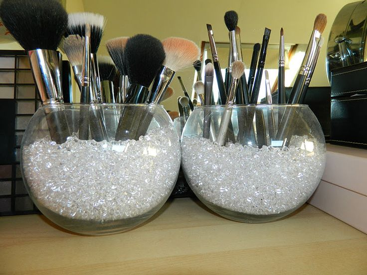 Use a fishbowl & fill it with colorful pebbles as a holder for your makeup brushes.