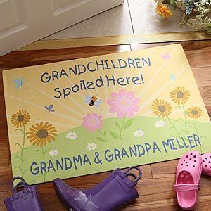 Personalized Grandparent Doormat - Grandchildren Spoiled Here . $17.20. Our personalized doormat is the perfect gift for the grandparent that likes to spoil their grandkids!We'll custom personalize any 2-line personalization at the top of the exclusive design, along with any 1-line personalization below. The perfect addition to any home! Makes an exceptional personalized gift for someone special or even for yourself!