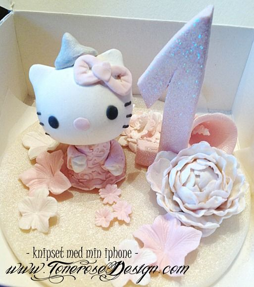 Hello Kitty marzipan cake decor =) hello kitty kakepynt