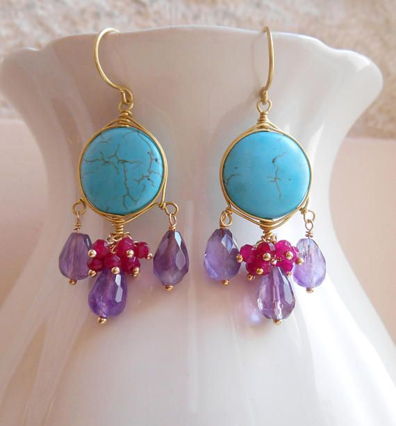 A lovely and vibrant kiss of of color, Idylle gemstone chandelier earrings will soon become your favorites! Smooth, saturated discs of vibrant turquoise howlite in combination with purple amethyst briolettes and ruby jade faceted rondelles, give these earrings their brilliant color
