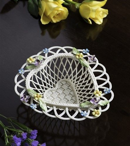 Belleek China Flowers Of Spring Basket. A woven heart shaped basket adorned with native spring flowers. Forget me not primrose and columbine are all native to Ireland.