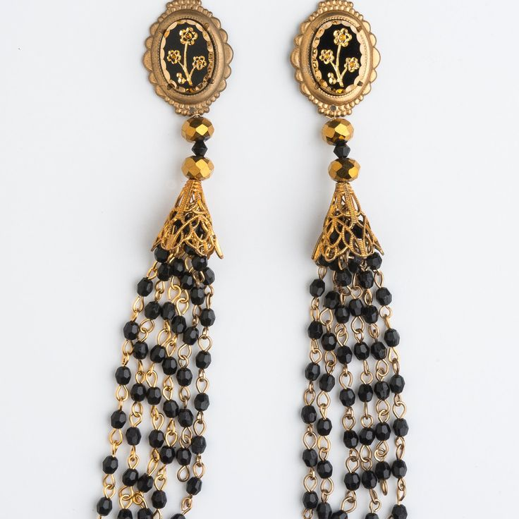 These beautiful long Tassel Earrings will tickle your shoulders whilst they tickle your fancy. Vintage Czech Glass Floral carved jet glass cameo from the 50's is adorned with golden Swarovski crystals and long trails of rosary. Golden Grail Earrings