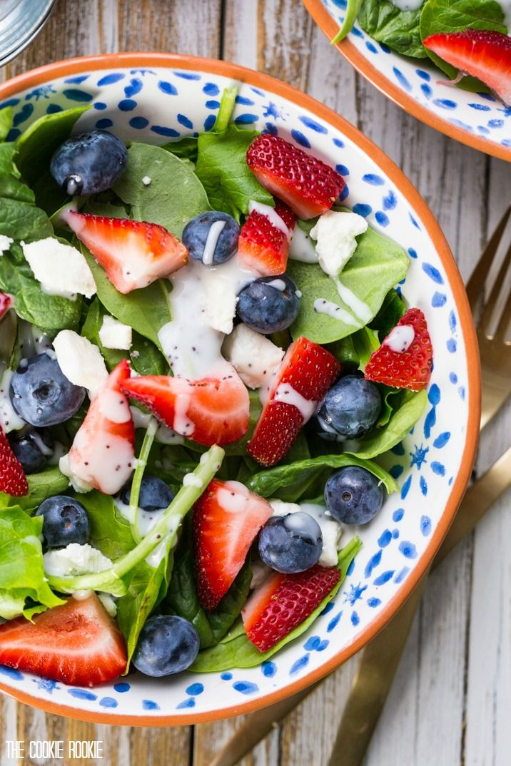 Red White and Blue Mason Jar Salad! So cute and easy. Perfect for Memorial Day and Fourth of July! Strawberry and Blueberry Salad with Feta. Yum.