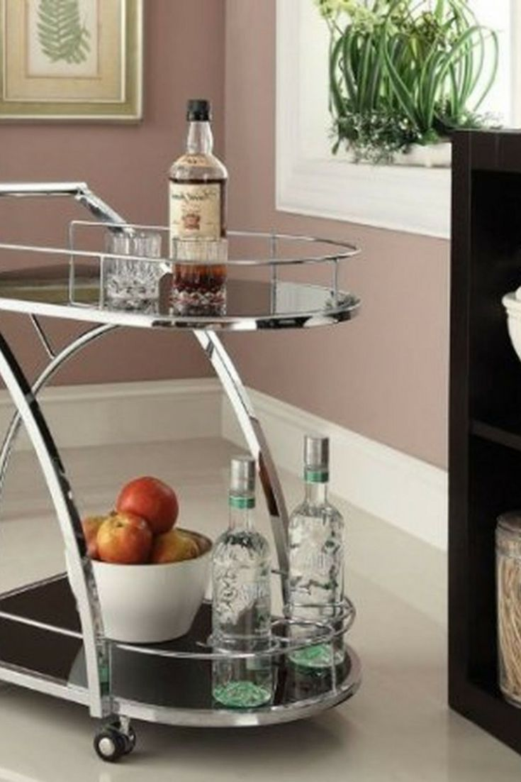 Whether it's an actual home bar or a cart, a beverage station adds instant glamour to your living or dining room. [Home Bar, Bar Cart,  Home Bar Ideas, Bar Cart Ideas, Bars For Small Homes, Setting Up A Home Bar, Chrome Bar Cart, Bar Glassware]