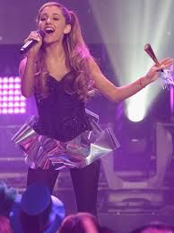 Ariana grande is so cute in that dress! I also love her song problem.