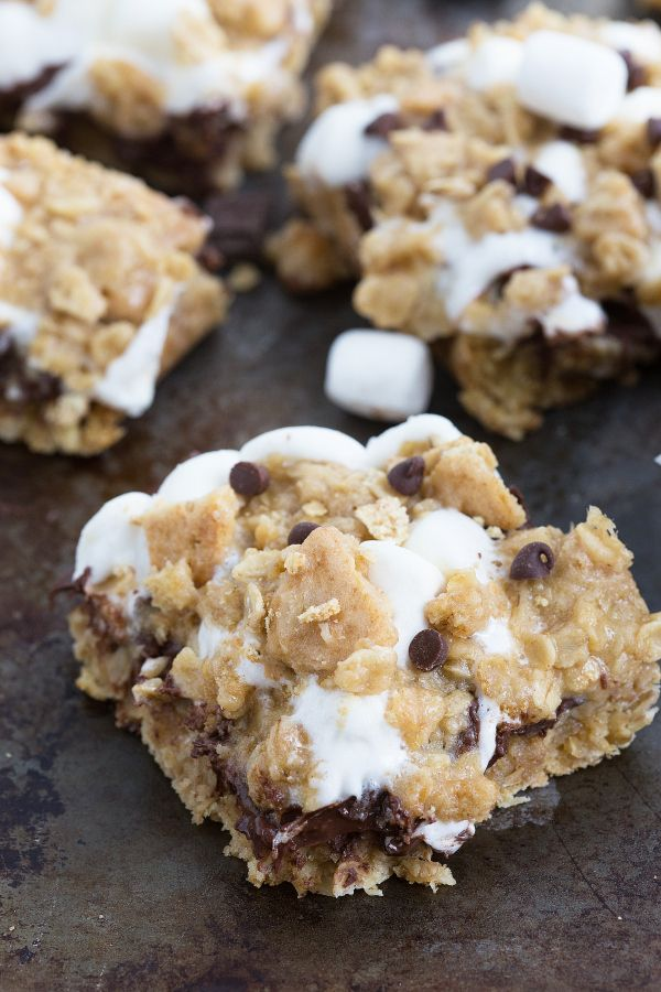 oatmeal cookie s'mores bars; one layer of oatmeal cookie dough, then chocolate chips sprinkled on top, then marshmallows, and finally oatmeal and graham cracker crumb cookie dough on top