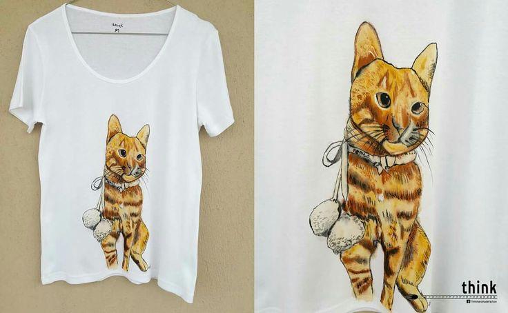 Handpainted kitten illustration on white t-shirt.