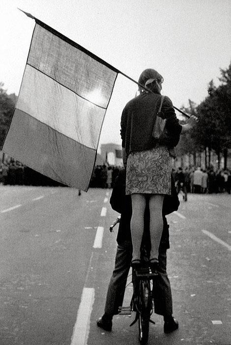 by Henri Cartier-Bresson, in May 1968, during the student rebellion in Paris, France.-Le socialisme ne peut venir que sur un vélo