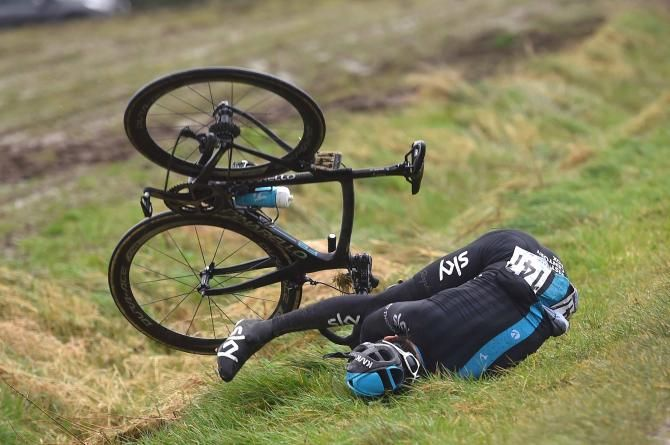 Geraint Thomas (Team Sky) hits the ground after being blown off his bike | Gent-Wevelgem 2015 | @CyclingNews