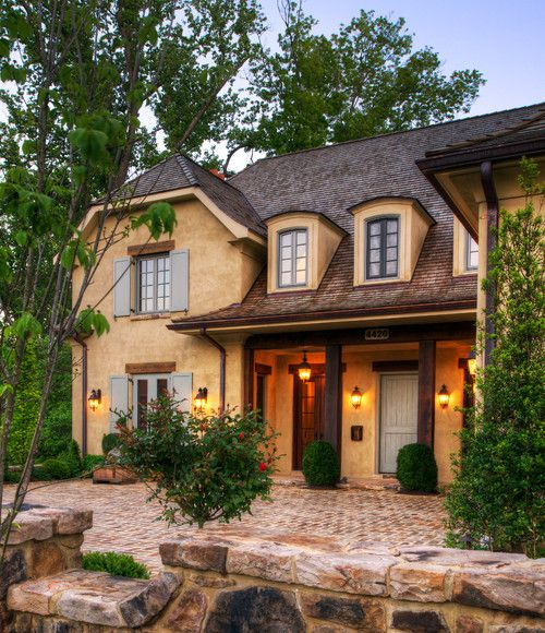 his charming home may be fairly new and big, but it was designed to have the warmth and patina of an old French country cottage. I love the details that Barnes Vanze Architects put into it, from brick floors to beamed ceilings.