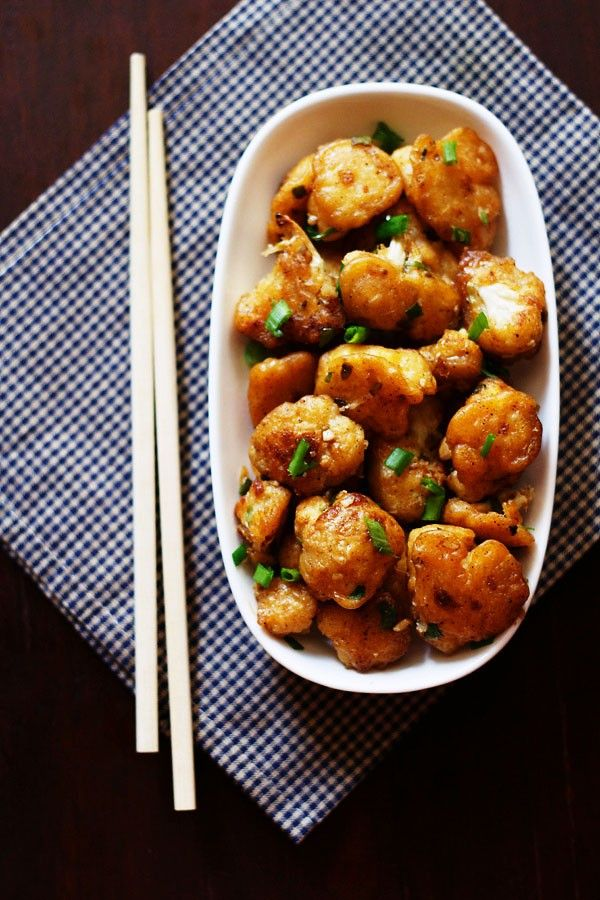 Gobi manchurian dry recipe - Popular indo chinese recipe of pan fried cauliflower florets coated with a spicy sauce.