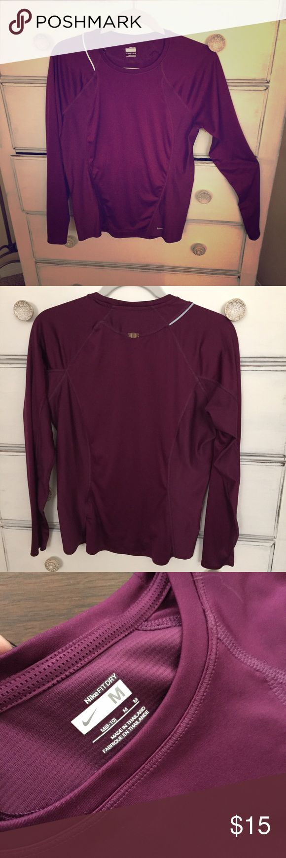 Purple Women's Nike Fit Dry L/S shirt, size Med Nike women's Fit Dry long sleeve t/shirt. Gorgeous purple w/ gray logo & decorative piping. Body: 100% poly, mesh side & sleeve panels: 76% poly, 24% spandex. Super breathable and comfy! Wicks sweat away so you don't smell like a foot when you run into the cutie at the juice bar after your workout. I may have worn it once. I'm not really sure. I don't remember ever wearing it and it looks new. Maybe if you buy it, I can get in shape vicariously…