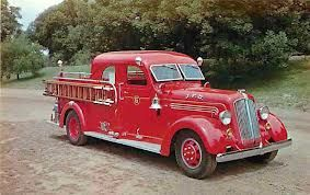 """1939 Seagrave Canopy Cab Fire Truck. A very stable old fire equipment company in Ohio. During WW2 many municipal departments repainted their equipment battleship grey as part of the """"war effort"""""""