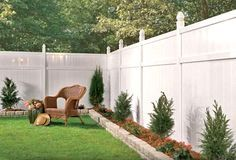 White vinyl fence with a small raised border. Very cute and clean.