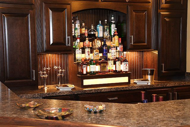 The dark color wood of this bar is BEAUTIFUL with the color of the counter top! #modern_wet_bar_ideas #wet_bar_ideas #ultimate_wet_bars