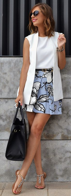 sleeveless white jacket, sleeveless white shirt and high waisted a-line skirt and flats